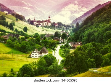 Dreamy summer landscape with mountain village and monastery in Germany, St. Trudpert, Muenstertal, Black forest