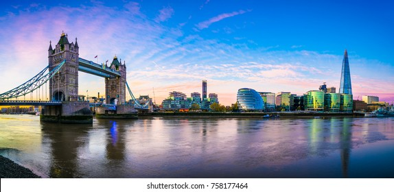 Dreamy sunrise panorama of Thames river with Tower Bridge and Morgan's lane