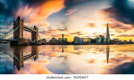 Dreamy sunset panorama of Tower Bridge and blurry sky