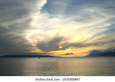 Dreamy sunset sky over Adriatic sea. Dramatic clouds reflecting sun rays.
