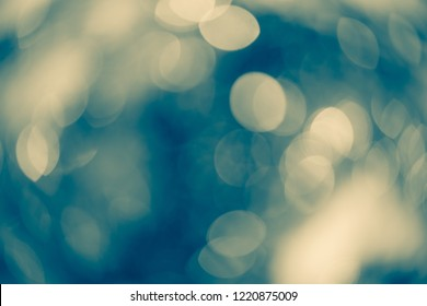 Dreamy teal and yellow bokeh lights for Xmas backdrop. defocused lights purple soft shade with flare, wallpaper for Xmas design.