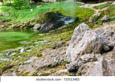 Dreamy waterfall and small emerald pond. Karst water. Fontanon of Goriuda. Friuli