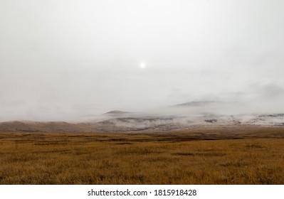 Dreary, foggy, empty, and barren winter landscape at the National Bison Range wildlife refuge, Montana, USA