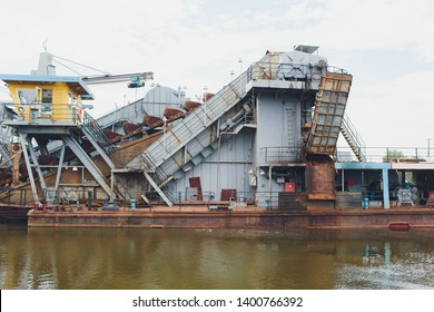 Dredger for absorption of trailer bunker during work on land reclamation for new ports. Suction dredge. Dredging in fairway of River. Cutter suction dredgers when working on land reclamation.