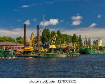 Dredger ship navy working to clean a navigation channel, Motlawa river, Gdansk, Poland
