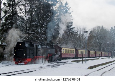DREI ANNEN HOHNE, GERMANY - DECEMBER 17, 2018: Steam engined narrow gauge train at the Brocken Bahn in National Park Harz in Germany during winter