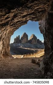 """Drei Zinnen (or """"Tre Cime Di Lavaredo"""") in Italy, seen from a cave."""