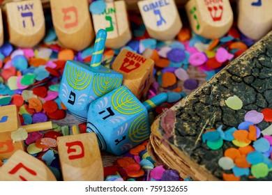 Dreidels for Hanukkah on wooden table wooden dreidel spinning