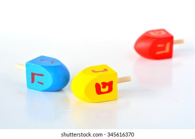 Dreidels (sevivons). It is a four-sided spinning top, played with during the Jewish holiday of Hanukkah. Holiday concept with copy space