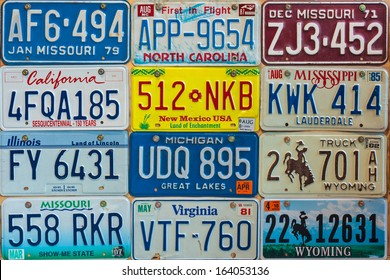 DREMPT, THE NETHERLANDS - NOVEMBER 15: Vintage car license plates on a wall on November 15, 2013 in Drempt, The Netherlands. In the U.S. each state issues its own car number plates.