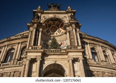 Dresde, Germany – December 9, 2014: Low angle shot of a detail of the Semperopera (Opera House) façade decorated with a Christmas tree in Altstadt