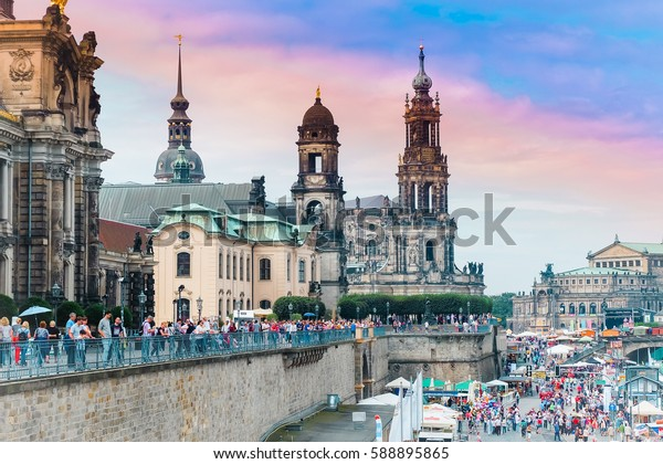 Dresden-  August, 2016- Tourist walk on the street near the river Elbe, Saxony, Germany.
