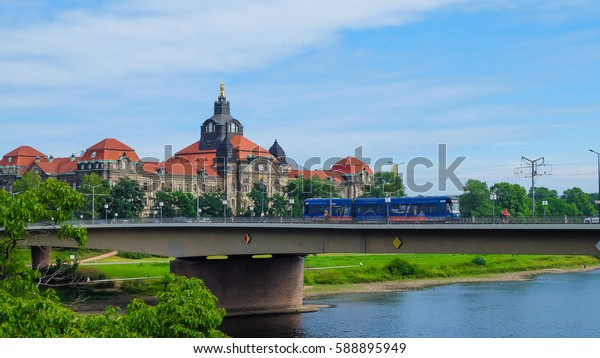Dresden-  August, 2016- Tourist walk on the street near the river Elbe- a bridge over the river Elbe in Dresden, Germany.