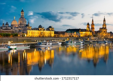 Dresden city skyline at Elbe river and Augustus bridge at sunset, Dresden, Saxony, Germany
