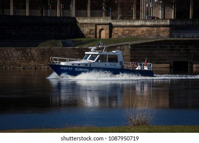 "Dresden, Germany - 04 06 2018: police boat at river Elbe in Dresden (translation: ""Polizei"" means ""Police"", the other signs mean the name of the boat)"
