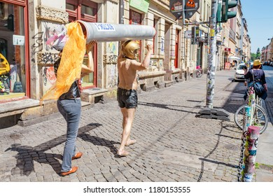 DRESDEN, GERMANY, 20 MAY 2018: Street performance - people depicting Russian Rocket Vostok at city street