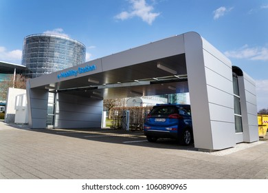 DRESDEN, GERMANY - APRIL 2 2018: Volkswagen E-mobility charging station in front of the Glaserne Manufaktur - Transparent Factory, car exhibiton space on April 2, 2018 in Dresden, Germany.