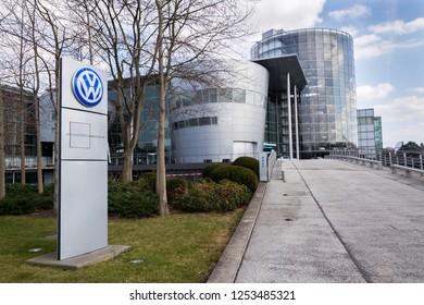 DRESDEN, GERMANY - APRIL 2 2018: Volkswagen company logo in front of the Glaserne Manufaktur - Transparent Factory on April 2, 2018 in Dresden, Germany.