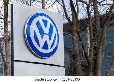 DRESDEN, GERMANY - APRIL 2 2018: Volkswagen company logo in front of the Glaserne Manufaktur - Transparent Factory on April 2, 2018 in Dresden, Germany.