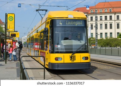 DRESDEN, GERMANY - APRIL 29, 2018: The modern yellow tram at the stop close up