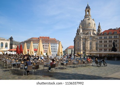 DRESDEN, GERMANY - APRIL 29, 2018: Street cafe on Neumarkt square Sunny April day