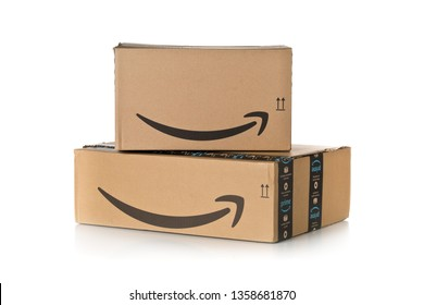 DRESDEN, GERMANY - APRIL 3, 2019 : Stack of Amazon Prime parcels over white background. Prime is a service offered by online retailer Amazon for faster delivery of orders.
