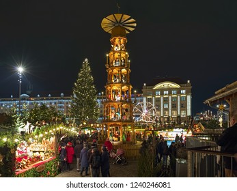DRESDEN, GERMANY - DECEMBER 6, 2017: Christmas pyramid at Striezelmarkt in night. The Striezelmarkt is the one of Germany's oldest documented Christmas markets. It was first mentioned in 1434.
