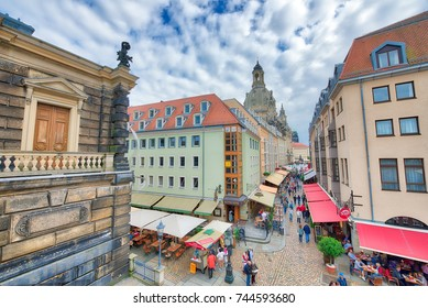 DRESDEN, GERMANY - JULY 15, 2016: Tourists visit city center. Dresden attracts 5 million people annually.