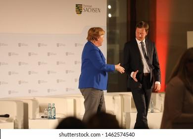 Dresden Germany - July 15, 2019: Angela Merkel and Michael Kretschmer during visit the city