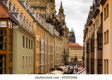 Dresden, Germany - July 26, 2017: A street with restaurants, leading to the Neumarkt square in the historic part of beautiful Dresden.