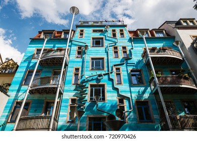 DRESDEN, GERMANY - JULY 28: Blue facade of one of the creative houses (Hof der Elemente) at the Courtyard Passage (Kunshoff Passage) in Dresden Neustadt, on July 28, 2017.
