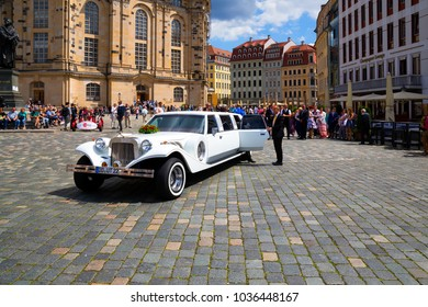 DRESDEN, GERMANY - JUNE 10, 2017: Wedding with long white limousine at the city square.