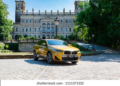 Dresden, Germany. June, 2018. A new model of the well-known and popular brand of BMW X2. Luxurious executive car on the street near a beautiful medieval castle.