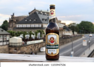 DRESDEN, GERMANY - MAY 10, 2018: Feldschlosschen pilsner beer bottle in Dresden. 1,300 breweries in Germany produce some 5,000 brands of beer.