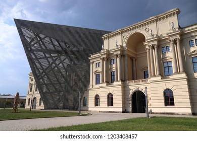 DRESDEN, GERMANY - MAY 10, 2018: Bundeswehr Military History Museum in Dresden, Germany. The new building opened in 2011 was designed by Daniel Libeskind in deconstructivism style.