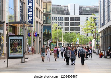 DRESDEN, GERMANY - MAY 10, 2018: People visit modern shopping street in Dresden, Germany. Dresden is the 12th biggest city in Germany.