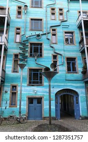 DRESDEN, GERMANY - MAY 10, 2018: Kunsthof passage in Neustadt district of Dresden. Kunsthofpassage is a set of inner courtyards rejuvenated with modern art and quirky restaurants.