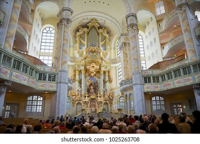 DRESDEN, GERMANY - MAY 18, 2010: Unidentified people visit famous Frauenkirche cathedral in Dresden, Germany. Frauenkirche originally was built in 1743.