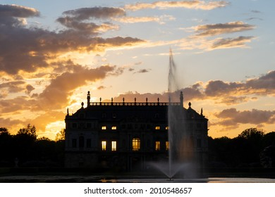 """Dresden, Germany - May 21 2021: The Palais in the """"Großer Garten"""" during sunset. It is a baroque Lustschloss in the middle of a public park in Dresden."""