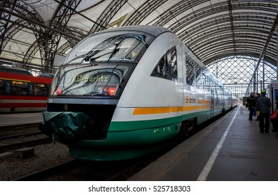 Dresden, Germany - November 27, 2016 - Modern white, green and yellow suburban train in the station Dresden - Hauptbahnhof (main railway station).