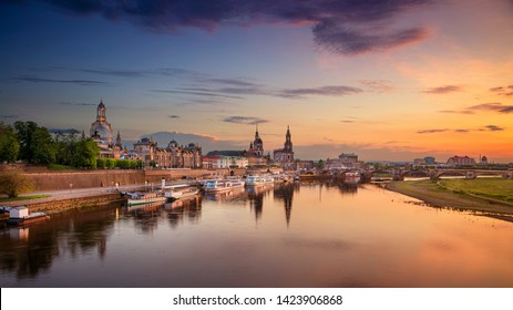 Dresden, Germany. Panoramic  cityscape image of Dresden, Germany with reflection of the city in the Elbe river, during sunset.