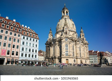 DRESDEN, GERMANY - SEPTEMBER 17, 2014: People walk in the center of Old town, near Frauenkirche (Our Lady church)