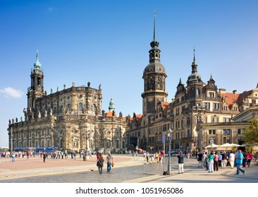 DRESDEN, GERMANY - SEPTEMBER 17, 2014: People walk in the center of Old town, near Cathedral of the Holy Trinity or Hofkirche and Dresden Castle.