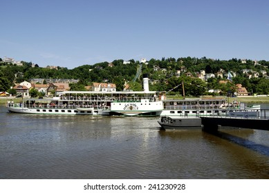 Dresden, Saxony, Germany - June 17, 2010: Historical paddle steamer with tourists on the river Elbe in Dresden.