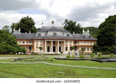 Dresden, Saxony, Germany - June 22, 2010: Visitors of Pillnitz castle in Dresden with the mountain palais and the great castle park.