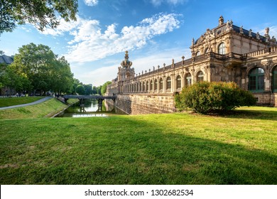 Dresden Zwinger palace in summer day, green grass on foreground