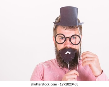 Dress affects how people see you. Man bearded hipster hold cardboard top hat and eyeglasses to look smarter white background. Guaranteed ways appear smarter. Tricks to seem smarter. Dress for success.