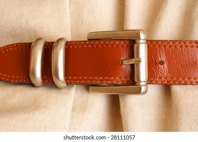 Dress with belt as a concept of saving in the financial crisis
