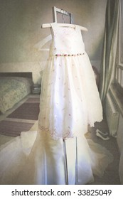 the dress of the flower girl before the wedding in a room