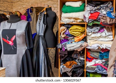 Dress making, fashion industry, make and mend.Billet colorful fabrics in disarray in the closet.